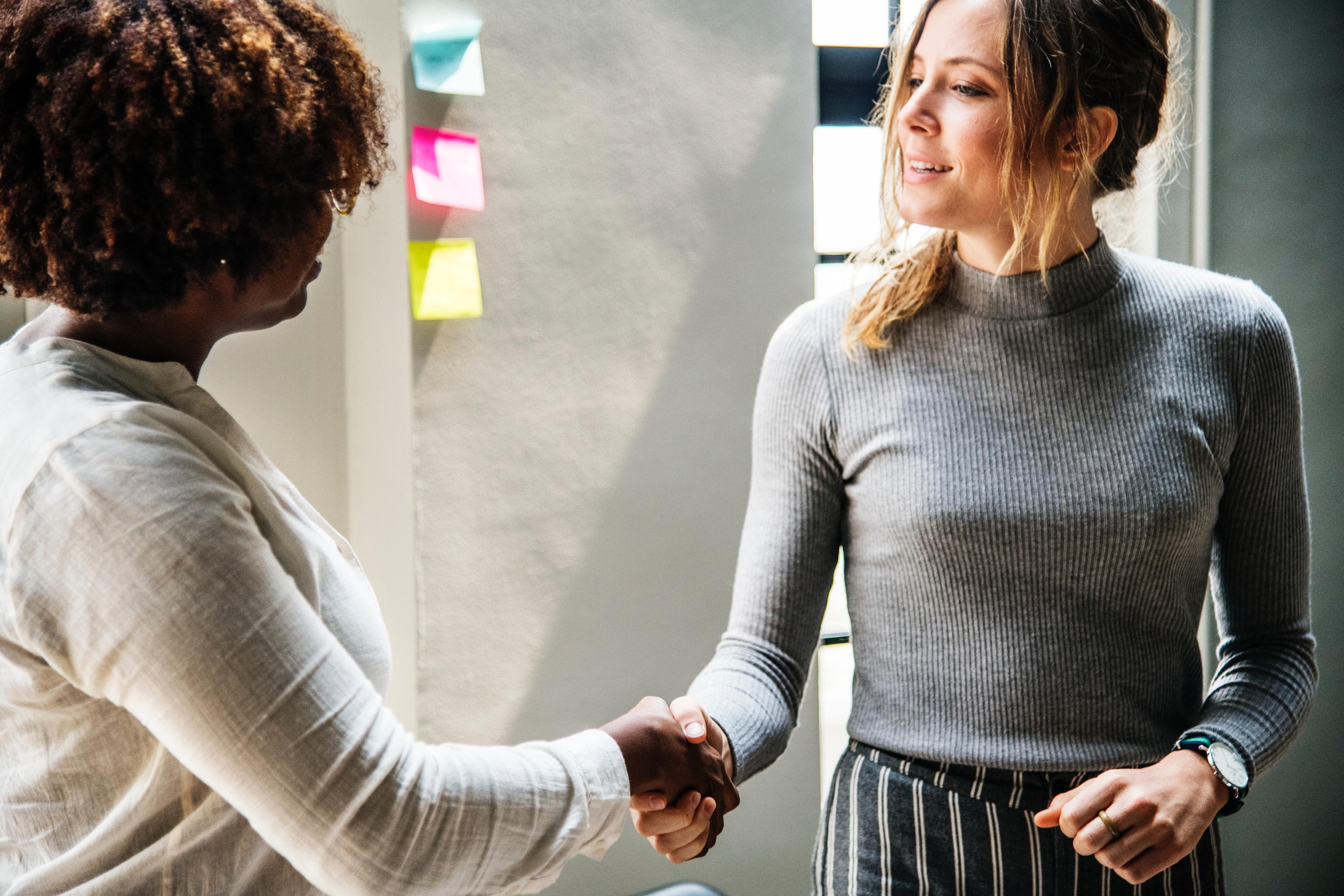 Women in Finance Shake Hands